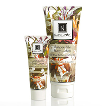 All natural and cruelty-free Honeysuckle Body Lotion, packaged in 1oz and 6oz.